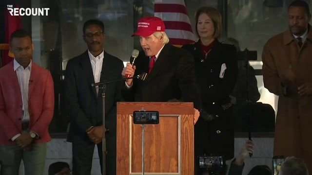 """""""Lock him up!"""" chants erupt in reference to GA Gov. Kemp at Lin Wood & Sidney Powell's election fraud conspiracy event."""