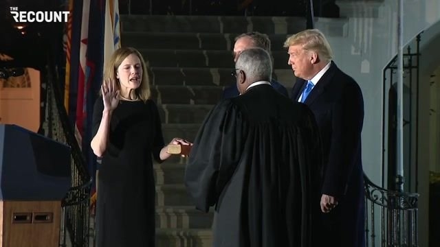 Trump looks on as Justice Clarence Thomas swears in Amy Coney Barrett to the Supreme Court