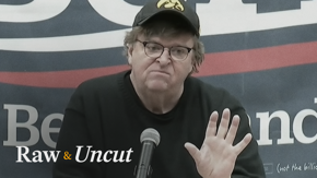 Filmmaker Michael Moore criticizes the DNC for changing the Democratic debate eligibility rules while campaigning for Bernie Sanders in Iowa