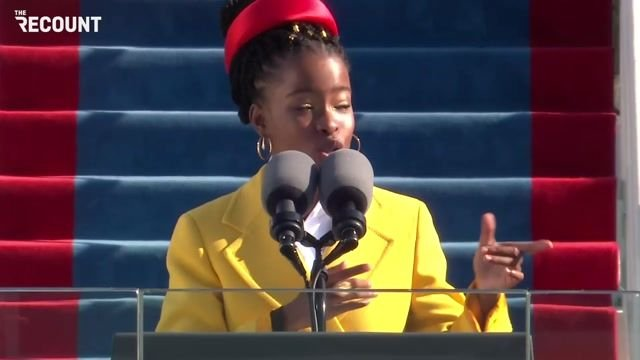 Amanda Gorman delivers the inauguration poem. At 22, she is the youngest poet to read at a presidential inauguration.