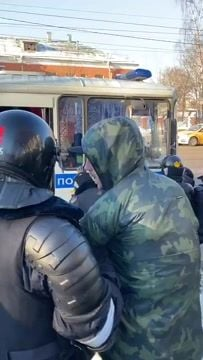 Police detain some of the more than 200 protesters showing support for Kremlin-critic Alexei Navalny during his hearing.