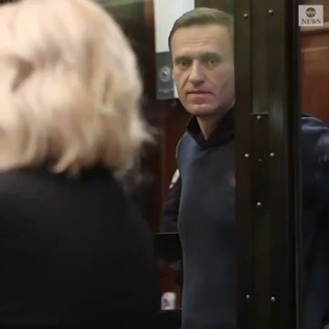 Kremlin-critic Alexei Navalny stands in glass cage during court hearing that could jail him for up to three years.