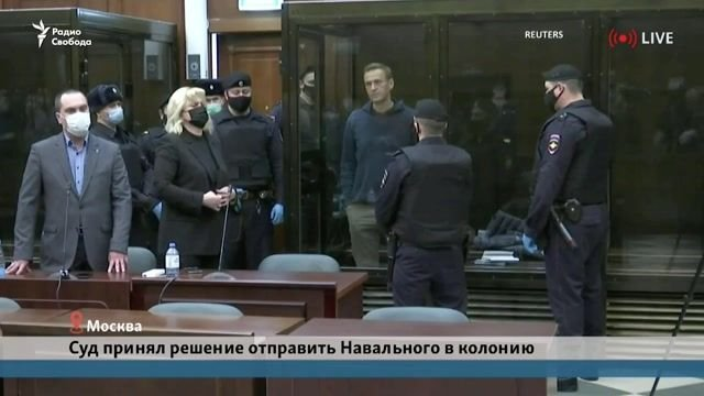 Russian opposition leader Alexei Navalny waves to his family as he is being sentenced to 3.5 years in prison.