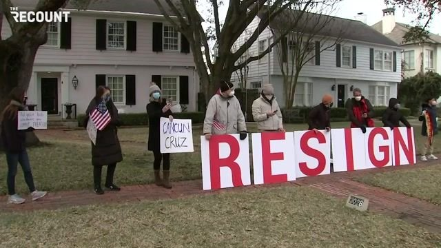 Protesters await Sen. Ted Cruz's arrival at his Texas home.