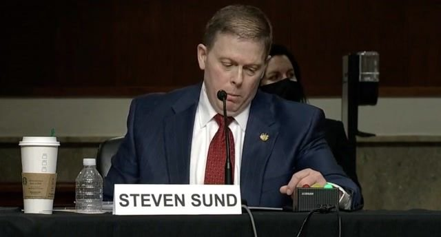 Sen. Cruz (R-TX) is on his phone while Former Metropolitan PD Chief of Police Sund testifies about the events on Jan. 6.