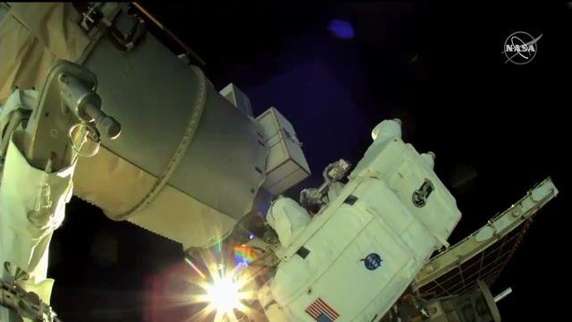NASA's Kate Rubins and JAXA's Soichi Noguchi use teamwork to complete tasks on the International Space Station.